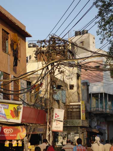 Twisted spider web of overhead electrical wires in Old Delhi.