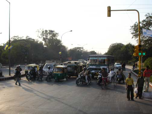 Traffic in Delhi at a stop light.
