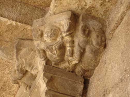 Carvings with faces destroyed.